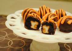 Brownie Bites with a Hershey Pumpkin Spice Kiss inside.  Yummy!  Halloween candy