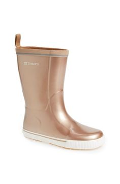 Free shipping and returns on Tretorn 'Skerry Metallic' Rain Boot (Women) at Nordstrom.com. A metallic finish adds subtle shimmer to a classic rain boot crafted from waterproof natural rubber. A cozy microfleece lining and molded EcoOrthoLite® insole complete the weather-ready style.