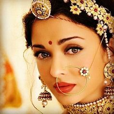 OMG: The gorgeous Aishwarya Rai as an Indian Bride with exquisite, distinctive Indian bridal jewellery, including matha patti with maang tikka (on hair), nath (on nose) and jhumka earrings. Opal Jewelry, Indian Jewelry, Wedding Jewelry, Tiffany Jewelry, Diamond Jewellery, Cute Jewelry, Diy Jewelry, Jewelry Ideas, Jewelry Logo