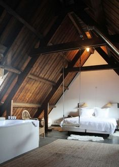 An attic bedroom at the Lloyd Hotel in Amsterdam, complete with swing