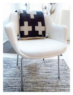 Kilta chair and By Nord Knitted Cross throw. The Kilta chair (design by Olli Mannermaa) is a Finnish design classic. It was first introduced in 1955.