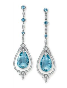 A PAIR OF DIAMOND AND AQUAMARINE EAR PENDANTS, BY TIFFANY & CO.   Each suspending a faceted aquamarine briolette drop, swinging within a circular-cut diamond frame of foliate motif, from a circular-cut diamond chain, spaced by a collet-set and square-cut aquamarine, to the collet-set aquamarine surmount, mounted in platinum  Signed T & Co. for Tiffany & Co., no. 24601994  20th century