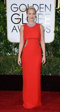 Jennifer Lawrence The 25-year-old Joy star was an elegant sight on the red carpet in a sleeveless red Dior gown which featured side cut-outs and a sleek floor-length hemline. For a finishing touch, Lawrence accessorized her brilliant crimson number with an elaborate Chopard diamond choker.
