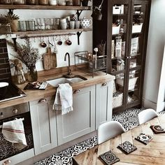 Trade in traditional kitchen cupboards for shelves and display a more cluttered but chic look. The time for hiding your lovely mugs and dinnerware is gone.
