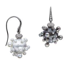"""#YatzerGiftGuide >> UNAMED EARRINGS BY THEODOROS >> Like something out of a fairytale, the uNamed earrings by Greek jeweller @Theodoros_jeweler, are mystifying spheres comprised of one white South sea and one black Tahitian pearl also encrusted to the hilt with smaller pearls and diamonds that """"stud"""" their bodies, bringing them to life. Unsurprisingly, childhood dreams form the basis of the designer's entire collection in which he is forever questioning, """"What distinguishes reality?""""…"""