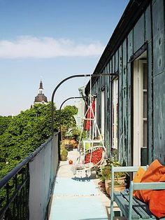 hanging chair on sunny balcony