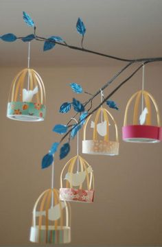 Bird cages made from pint size ice cream lids