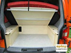 Under bed storage compartment with opened lid for easier access.