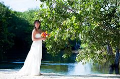 Gorgeous bride by one of the rivers at @Hacienda Tres Ríos Resort, Spa  Nature Park resort in the Riviera Maya for a destination wedding. Mexico wedding photographers Del Sol Photography.