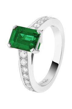 Van Cleef & Arpels Pushkar Solitaire in platinum, set with round diamonds and a 1.35ct emerald-cut emerald.