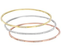 Chic and modern, this set of three bangles is perfect for stacking. The bangles shine in rose gold-plated, gold-plated, and rhodium-plated metal... Shop now