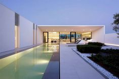 http://www.contemporist.com/2014/04/07/jesolo-lido-pool-villa-by-jm-architecture/