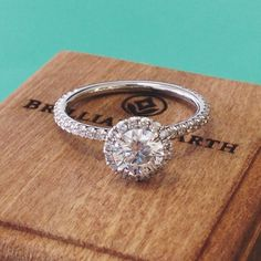 A delicate and sparkling halo engagement ring.