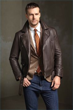 Preppy style meets a cool aesthetic with smart tailoring, jeans, and a brown leather jacket from Brunello Cucinelli.