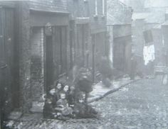 Children sitting outside a tenement in Dublin, Ireland. Dublin House, Irish People, Photo Engraving, Kingdom Of Great Britain, Dublin Ireland, Book Of Life, Old Pictures, More Photos, Street Photography