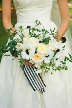 Classic & Chic Bridal Bouquet Comprised Of: White Anemones, White Tulips, White Roses, White English Garden Roses, Cream Roses, White Sweet Peas, Black Scabiosa & Greenery + Foliage Hand Tied With A White/Black Striped Ribbon>>>>
