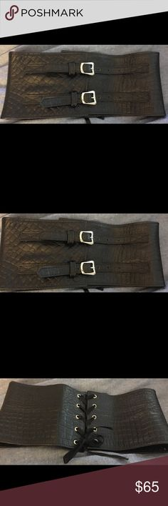 Leather corset belt Lovely black leather corset belt . Silver metal boiler buckles in the front and ties in the back like a corset . Size small , 28 inches . 5.5 inches wide . Very stunning on. Soft leather ! Like new !! Accessories Belts