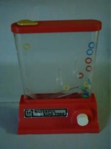 Oh my goodness!! My Aunt had one of these and I LOvED playing with it. VINTAGE WATERFUL RING TOSS BY TOMY 1980'S childhood-memories