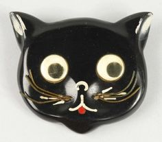 This bakelite kitty brooch has moveable eyes. Don't know what it sold for, but the estimate was $300-$500 US.