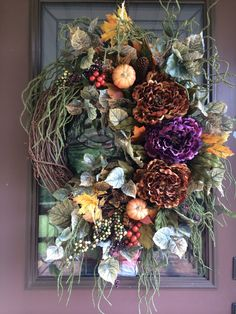 Autumn Wreath, Fall Wreath, Peony Wreath, Grapevine Wreath, Elegant Wreath, Front Door Wreath This wreath design has it all, natural beauty, elegance and a wonderful, vibrant fall color scheme! There are chocolate and dark purple peonies, realistic large leaf greenery cascading down one side and mini- berry strands throughout. This design is topped off with autumn maple leaves, multi-colored berries, pinecones, and small pumpkins! This wreath would add a gorgeous pop of color to a…