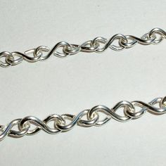 Figure Of 8 Chain.i used all my head pin scraps cut to the same length,made several figure 8's connected them all to make a bracelet. Added charms and end clasp.