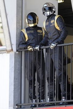 Daft Punk wear custom suits while watching the Monaco Formula One Grand Prix at the Circuit de Monaco in Monte Carlo.