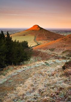 First light on Roseberry Topping, North Yorkshire Moors © John Patrick. I think it's my favourite. Yorkshire England, Yorkshire Dales, North Yorkshire, Northern England, Grand Canyon, England And Scotland, English Countryside, Landscape Photography, Scenery Photography