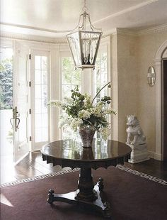 A Round Antique Empire Mahogany Table Is Statement Piece In An Entry This Would