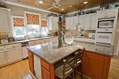 451 Chimney Rock Drive, Sherwood AR - Trulia white cabinets with white appliances and wood stained island (want different color stain) like the cabinet style