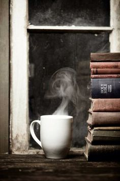 Steaming cup of coffee on a wood table next to a stack of books and bible Coffee And Books, I Love Coffee, Hot Coffee, Momento Cafe, Steaming Cup, Coffee Photography, Book Nooks, Reading Nooks, House 2