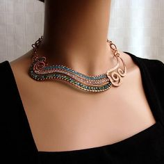 """Hammered into spirals, wrapped with crystals, formed into links – upcycled copper forms this River collar that will swirl beautifully around your neck as it transitions from smooth-flowing crystals to copper rapids. The river winds for 5.5"""" (14cm) and is about 1"""" (2.5cm) wide. The focal"""