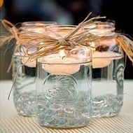 Mason Jars and Candles Keep it simple and use floating candles as your centerpiece. They'll glisten in clear Mason jars. Mason Jars and Candles Keep it simple and use floating… Party Planning, Wedding Planning, Deco Champetre, Do It Yourself Wedding, Mason Jar Centerpieces, Simple Centerpieces, Centerpiece Ideas, Easy Table Decorations, Country Wedding Centerpieces
