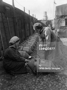 Getty Image caption 'Women In Uniform During The First World War: The Women's Royal Naval Service, c. 1918, Two WRNS ratings on the quayside at Lowestoft checking the air pressure in Electric Contact (EC) mines circa 1918. Note the mines laid out in the background. They are being connected to form mine nets which were used along the French and Belgian coast to conter the operations of coastal U-Boats, circa 1918. (Photo by G P Lewis/ IWM via Getty Images)'. Probably IWM Q 19648.