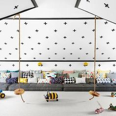 Attic Playroom with comfy pillows the length of the room and rope swings.  Awesome ideas!