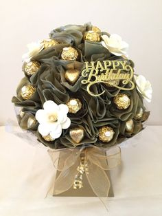 A Stunning Chocolate Bouquet which contains 42 Chocolates: 30 Ferrero Rochers and 12 Milk Chocolate Hearts. The chocolates are wrapped between