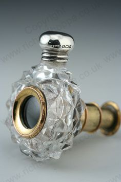 RARE ANTIQUE & VINTAGE SCENT PERFUME BOTTLES: ANOTHER VIEW OF THE 1884 CUT CRYSTAL SCENT PERFUME BOTTLE WITH OPERA GLASS TELESCOPE, SILVER TOP.