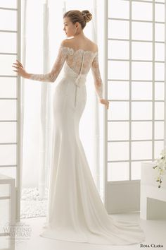 Image from http://www.weddinginspirasi.com/wp-content/uploads/2015/06/rosa-clara-2016-bridal-collection-off-the-shoulder-long-sleeves-white-sheath-wedding-dress-back-view-dado.jpg.