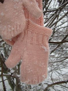 Pink mittens happy in the snow.