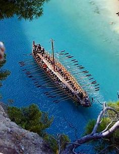 Replica of Argo ship, sails in the Corinth canal. The legendary ship propelled by 50 oars-men and sail on which according to Greek mythology, Jason and the Argonauts sailed from Iolcos to the Black Sea to retrieve the Golden Fleece.