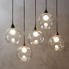 high five. Industrial modern chandelier suspends five glass globes from black…