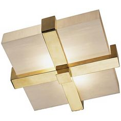 A on-trend cross of natural brass trim squares up this flushmount ceiling light to give structure to its glowing marbleized glass.