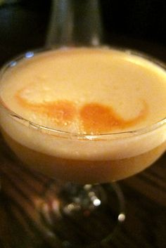 mustachi-ode  cool looking drink, but you need to make a pistachio syrup...see http://savoystomp.com/#