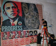 Fairey installing his Obama mural on the side of restaurant Marvin in Washington, D.C.