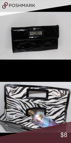Patent Leather Clutch by Gap Black Patent Leather Clutch by Gap. Internal has zebra print material. The inside is clean on the inside of the lid  has a brown stain on both sides, not sure how that happened aged perhaps overall the clutch is nice classy piece. All reasonable offers accepted, trying to clean out my closet. Size 12x7 GAP Bags Clutches & Wristlets