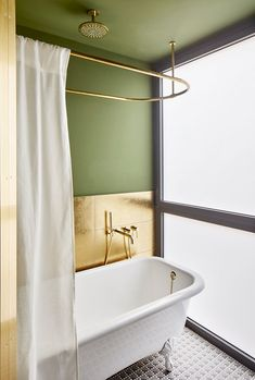 Stay in style: sophisticated rental apartment in Barcelona #interior #design #style #idea #inspiration #room #cozy #home #decor #bath #bathroom #tub #green #gold #modern