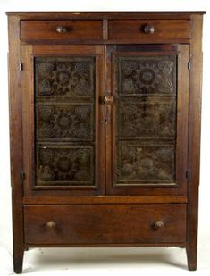 """19th c. Ohio, cherry and poplar wood, punch tin panel pie safe, single board top over two flanking dovetailed drawers, over two doors, each with three heart and star decorated tins, three heart and star tins on both sides, on squared legs, 57"""" h, 41"""" w, 16 1/4"""" d."""