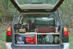 This guy made a platform bed to fit his car with storage underneath. $80. Wooo for car living