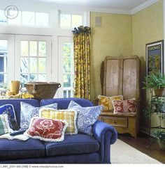 Family Room Denim Blue Sofa Fringed Pillows In Blue Toile Yellow Plaid And