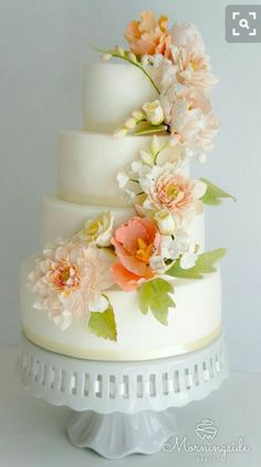 Gorgeous wedding cake with peach flowers  Lauren B Montana