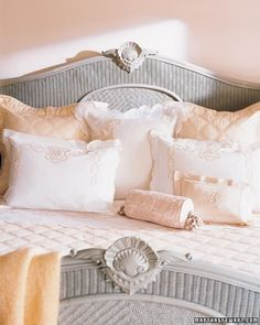 The bed expands the range of pinks with its French sheets and pillowcases and mohair throw.